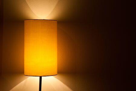 Lamp in darkened room