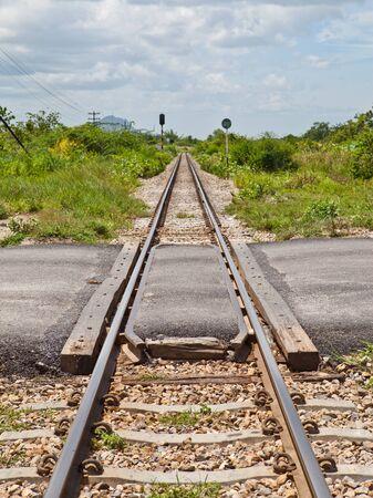 Road cross railway track Stock Photo - 11009619