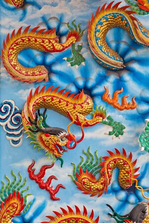 dragon on a wall in a Chinese temple photo