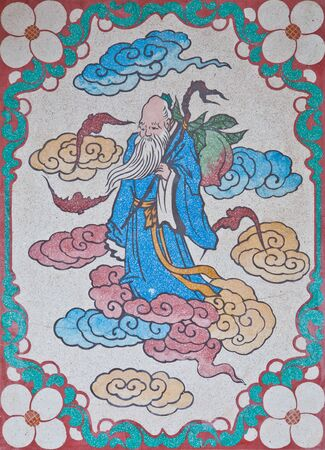daunting: Old man spirit on a wall in chinese temple