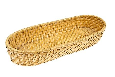 Wicker basket isolated on white background photo