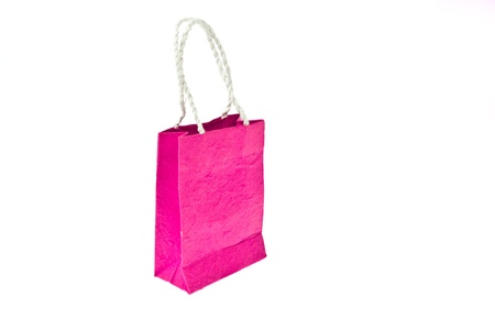 Pink mulberry paper bag isolated on white background photo