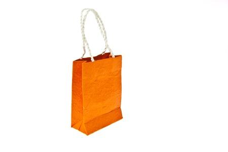 Orange mulberry paper bag isolated on white background photo