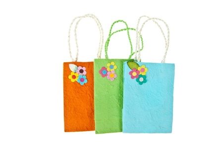 Colorful mulberry paper bag isolated on white background photo