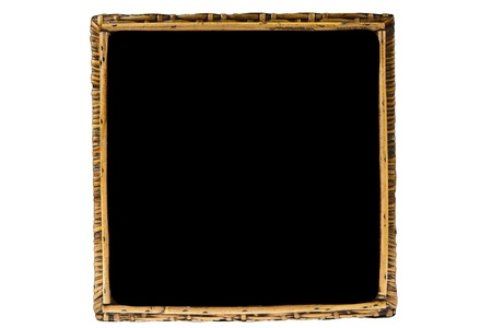 Rattan on black picture frame isolated on white background photo