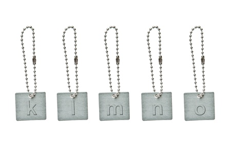 Silver metal key tag with small letter k-o photo