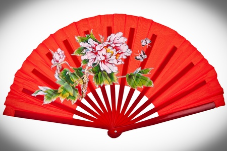 Red oriental chinese fan isolated on white background Stock Photo - 11779623