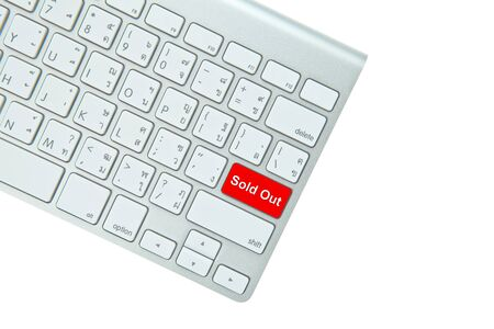 Red sold out button on computer keyboard isolated on white background photo