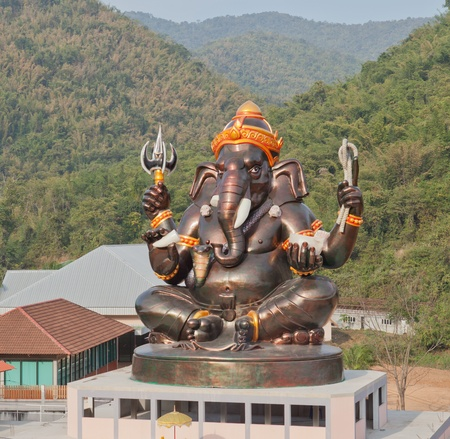 ganapati: Giant Hindu God Ganesh on top of the building in a temple in Thailand