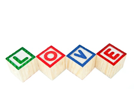 Love by block toy isolated on white background photo