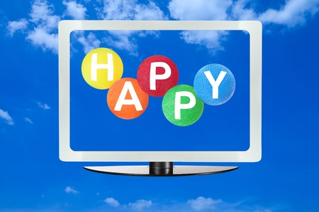 Computer screen with blue sky and word happy Stock Photo - 11999417