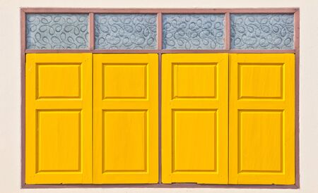 Traditional thai style yellow window photo