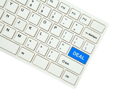 Wording Deal on computer keyboard isolated on white background photo