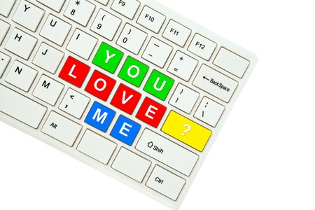 Wording You Love Me on computer keyboard isolated on white background Stock Photo - 11999222