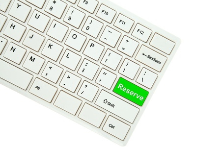 Wording Reserve on computer keyboard isolated on white background Stock Photo - 11999241