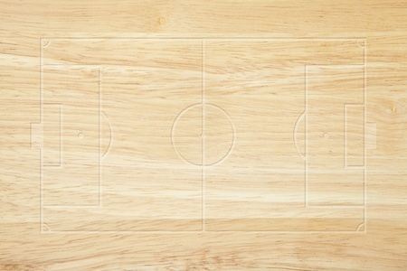 wood texture background: Soccer field layout on wood background