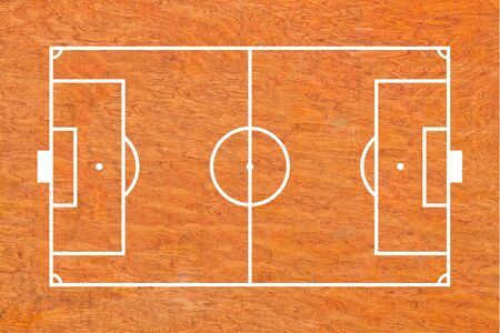 Soccer field layout on wood background photo