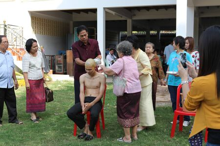 ordain: LOPBURI - NOVEMBER 19. Newly ordained Buddhist monks took a barth by his parents procession in Thailand on November 19, 2011 in Lopburi. Monk ordinations in Thailand are very important social events. Editorial