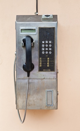 pay wall: Payphone on the wall