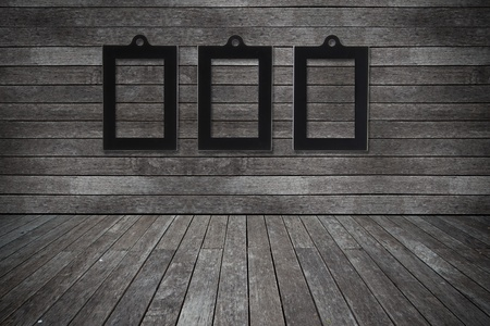 Grunge old wood texture room background with photo frame photo