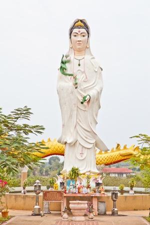 quan yin: White Quan Yin pouring from her vast Stock Photo