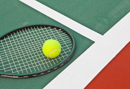 Tennis court at base line with ball and racket Stock Photo - 12998783