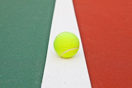 Tennis court at base line with ball photo
