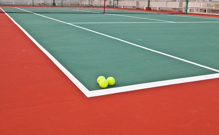Tennis court at base line with ball Stock Photo - 13129810