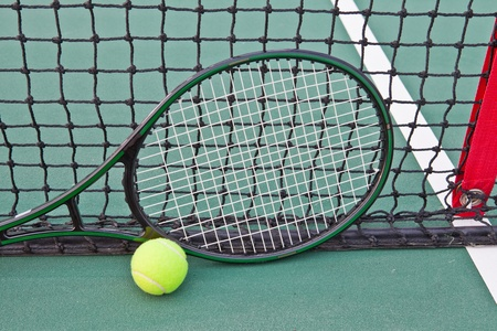 Tennis court with ball and racket photo