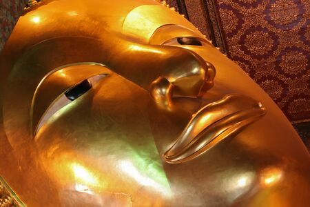 Golden Buddha head close up photo