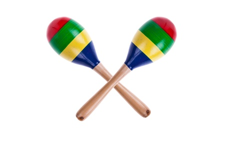 pair of colorful wooden maracas isolated on white background photo