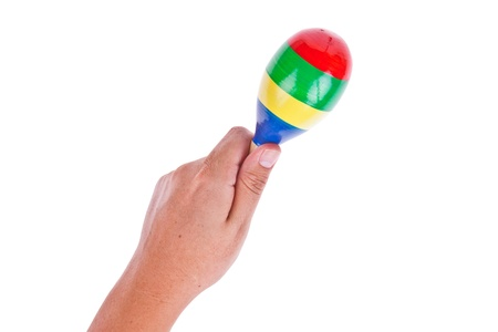 Colorful wooden maracas with hand isolated on white background photo