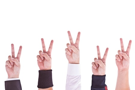 combined effort: Hands with victory sign Stock Photo