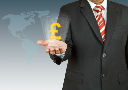 Businessman with pound symbol over his hand photo