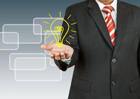電球を持ったビジネスマン 写真素材