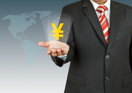 Businessman with Yen symbol over his hand Stock Photo