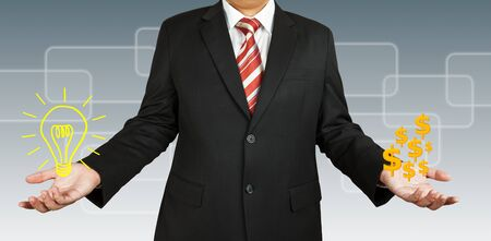 Businessman with idea and money Stock Photo