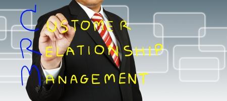 businessman writing customer relationship management ( crm ) concept Stock Photo - 13811714