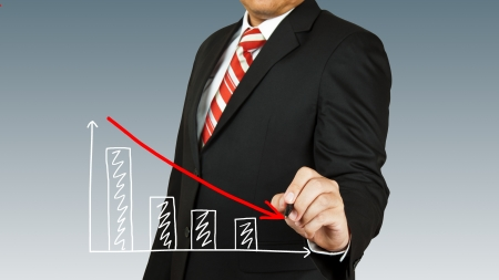 worse: businessman hand drawing chart red arrow Stock Photo