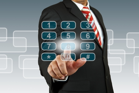 num: businessman hand pushing number pad screen