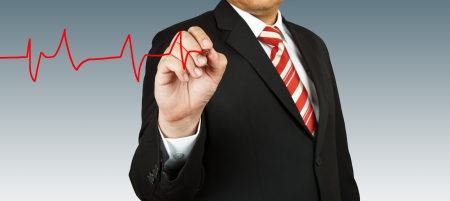 Businessman draw a pulse Stock Photo - 13986135