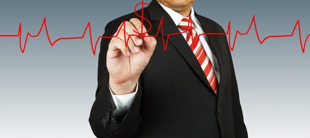 Businessman draw a pulse photo