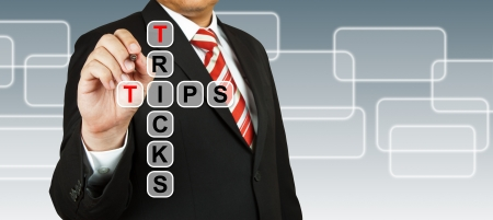 Businessman hand drawing Tricks and Tips Stock Photo
