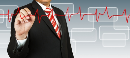 Businessman draw a pulse line Stock Photo - 14158277