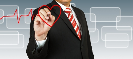 Businessman draw a pulse line with heart Stock Photo - 14158276