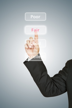 Businessman push Fair button photo