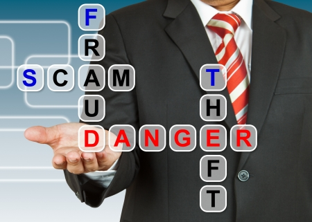 Businessman with the danger of fraud, scam, and theft photo