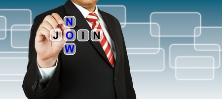 Businessman with wording Join Now Stock Photo - 14454863
