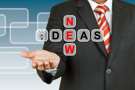 Businessman hand drawing New Ideas photo