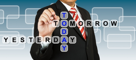 Businessman with wording Today, Yesterday, and Tomorrow photo